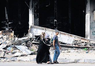 Libyans in the ruins of Misurata, where human rights abuses have led to a wave of racial hatred.