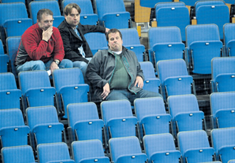 Bored ice hockey fans at the Finland versus Belarus game last week, which was perhaps all they could afford.