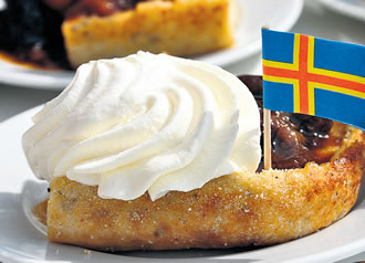 The delicious and filling Åland pancake, topped with whipped cream, jam and the flag of Åland.