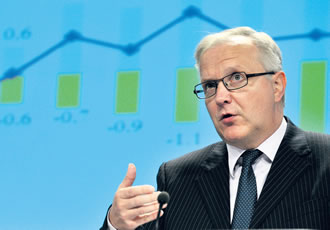 "Commissioner for Economic and Monetary Affairs Olli Rehn holds a press conference on November 7, 2012 at the EU Headquarters in Brussels. ""Europe is going through a difficult process of macroeconomic rebalancing, which will still last for some time. Our projections point to a gradual improvement in Europe's growth outlook from early next year"" Rehn said."