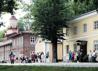 Visiting tourists on the main street in Fiskars.