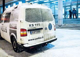 Police van outside Jyväskylä City Library where one person was stabbed during the presentation of a book on Finnish extreme right on 31 January.