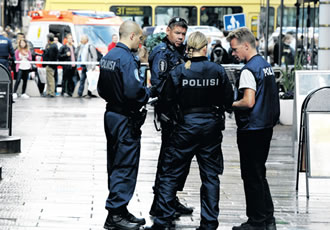 Police officers at the crime scene on 3 September.