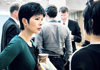 Project manager Christine Chang talking to some of the attendees at the 'Talent Available' event in Helsinki.