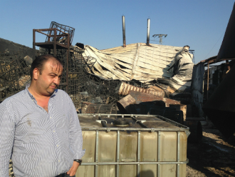 Ayman Hamada, the owner of Line Food in Gaza Israel, visited his tomato cannery on 13 August. Hamada said security cameras captured shells hitting his factory and a large fire burning.