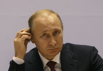Russian President Vladimir Putin listens to the speech of Indian Prime Minister Narendra Modi at The World Diamond Conference at Vigyan Bhawan in New Delhi on 11 December.