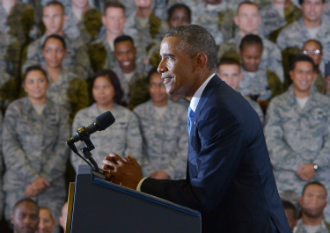 US President Barack Obama addresses troops following a visit to the US Central Command (CENTCOM) at MacDill Air Force Base in Tampa, Florida on 17 September.