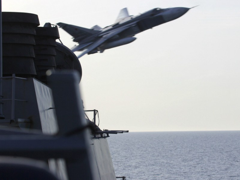 A Russian Sukhoi Su-24 fighter jet was pictured making a low-altitude pass by the USS Donald Cook, an Arleigh Burke-class guided-missile destroyer, in the Baltic Sea on 12 April, 2016.