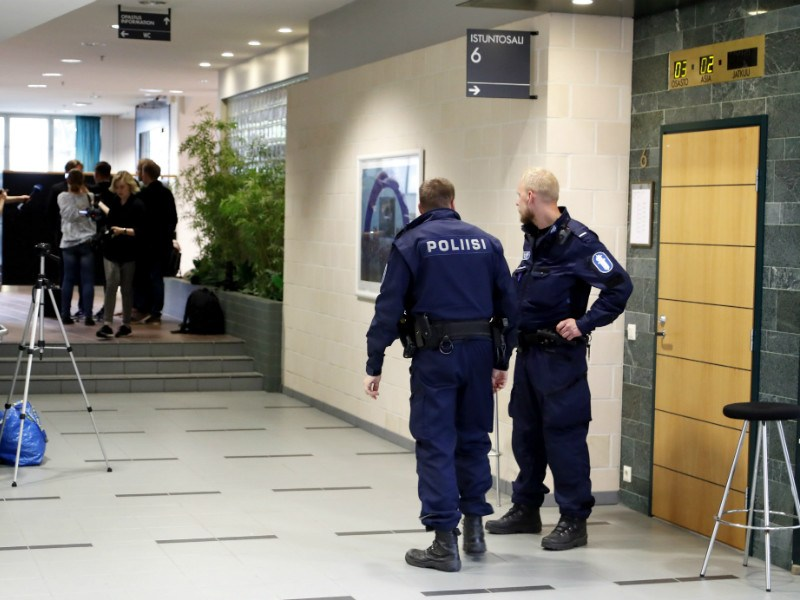 Police officers stood outside a courtroom as detention hearings for six members of the national volleyball team of Cuba were held at the District Court of Pirkanmaa in Tampere on 5 July, 2016.
