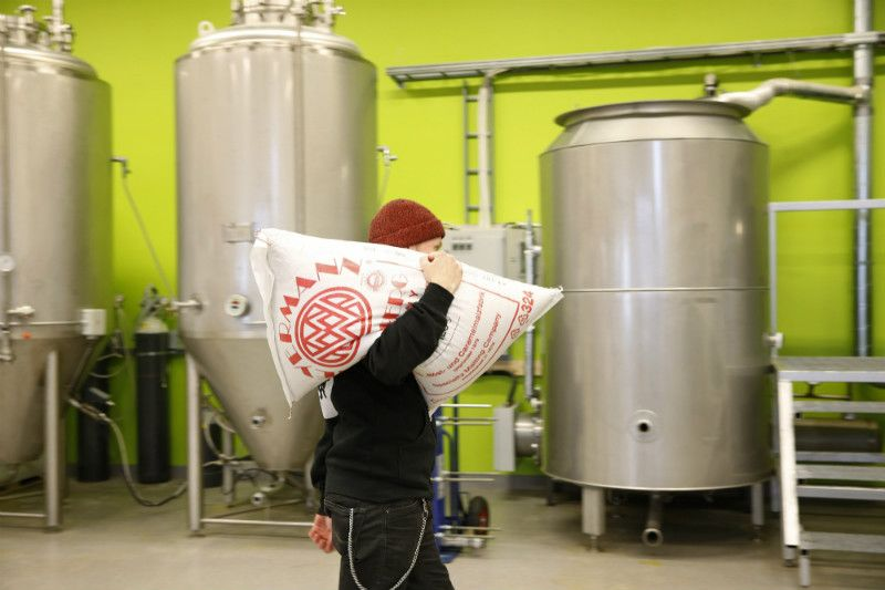 Timo Kanniainen, a co-founder and brewer at Sonnisaari Brewery, was pictured hauling a bag of malt in Oulu on 30 October, 2015.