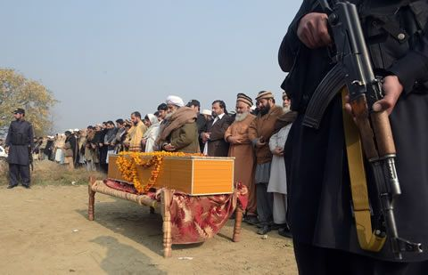 Pakistani relatives and residents offer funeral prayers for victims of the Bacha Khan university attack in Charsadda, about 50 kilometers from Peshawar, on January 21, 2016. Pakistan observed a day of national mourning for the 21 people killed when heavily-armed gunmen stormed a university in the troubled northwest, exposing the failings in a national crackdown on extremism.   LEHTIKUVA / AFP PHOTO / Aamir QURESHI
