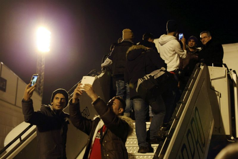 A handout photo distributed by the Police of Finland shows people boarding the first deportation flight to Iraq in February.