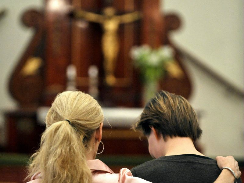 Two women were pictured in a church in Helsinki on 22 October, 2010.