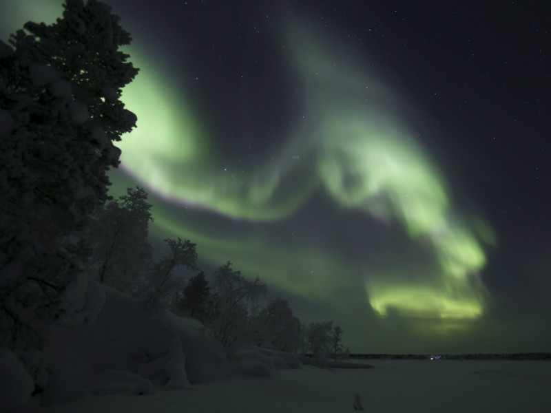 A night sky illuminated by the northern lights in Inari, Finnish Lapland, on December 25, 2017.