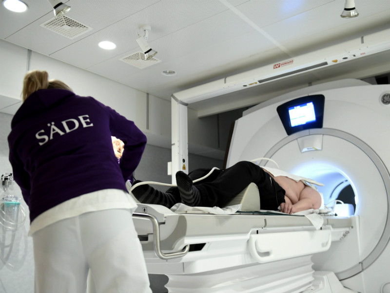 A patient being prepared for an MRI at the radiation therapy ward of the Department of Oncology of Helsinki University Central Hospital on 21 December, 2017.