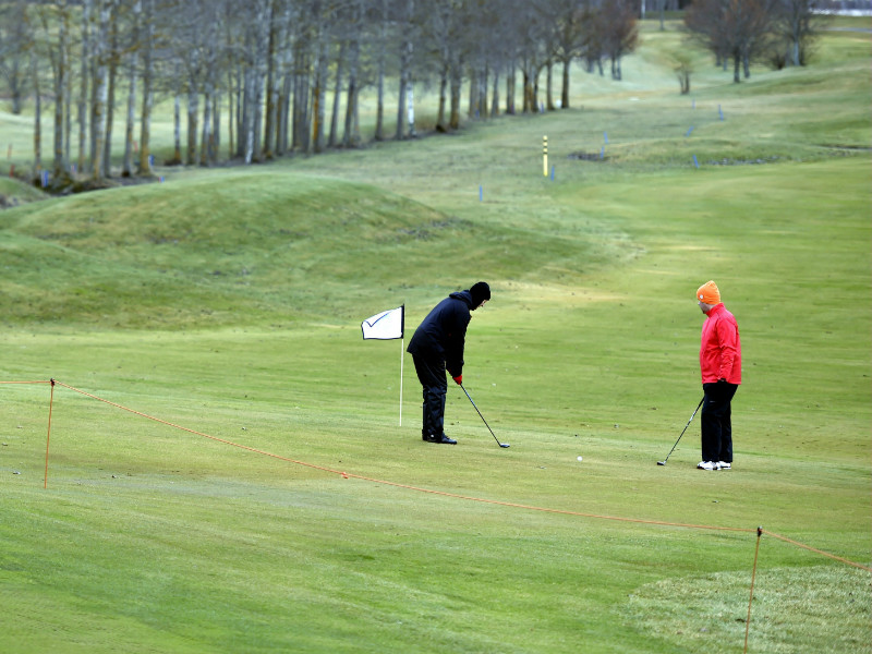 Tapio Kotka and Risto Koistinen played golf in the mild holiday weather at Ringside Golf in Espoo on 23 December, 2016.