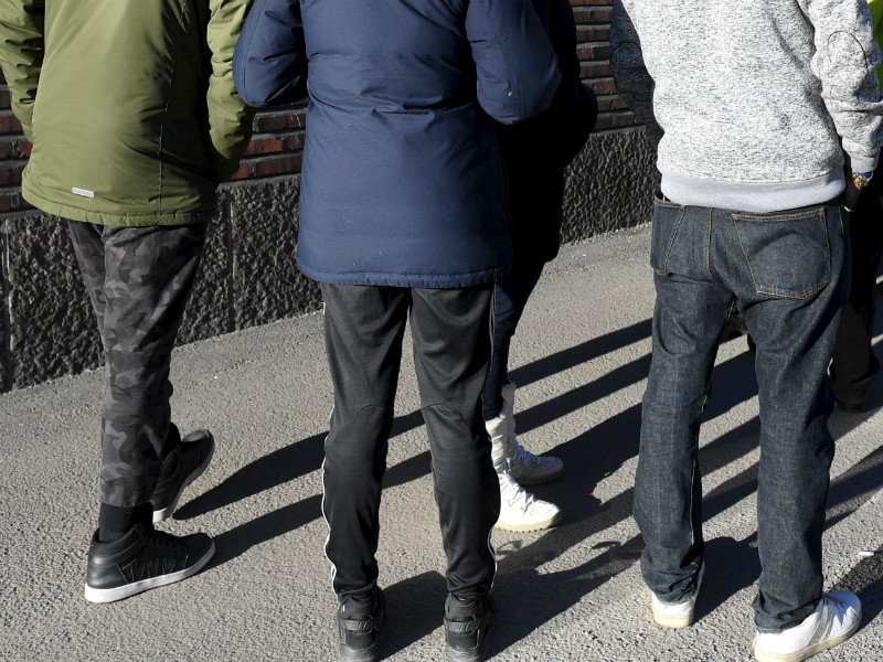 A queue of people outside an office of the Finnish Immigration Service (Migri) in Helsinki on 24 March, 2017.