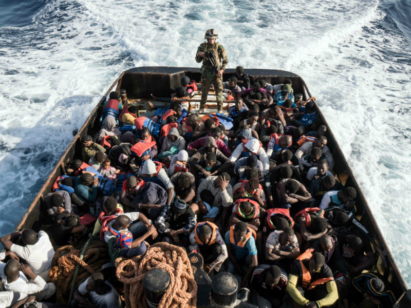 A Libyan coast guardsman stands on a boat during the rescue of 147 illegal immigrants attempting to reach Europe off the coastal town of Zawiyah, 45 kilometres west of Tripoli, on 27 June, 2017.