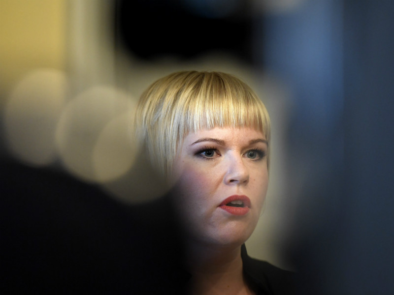 Annika Saarikko (Centre) was pictured speaking to reporters after being sworn into office as the Minister of Family Affairs and Social Services on 10 July, 2017.