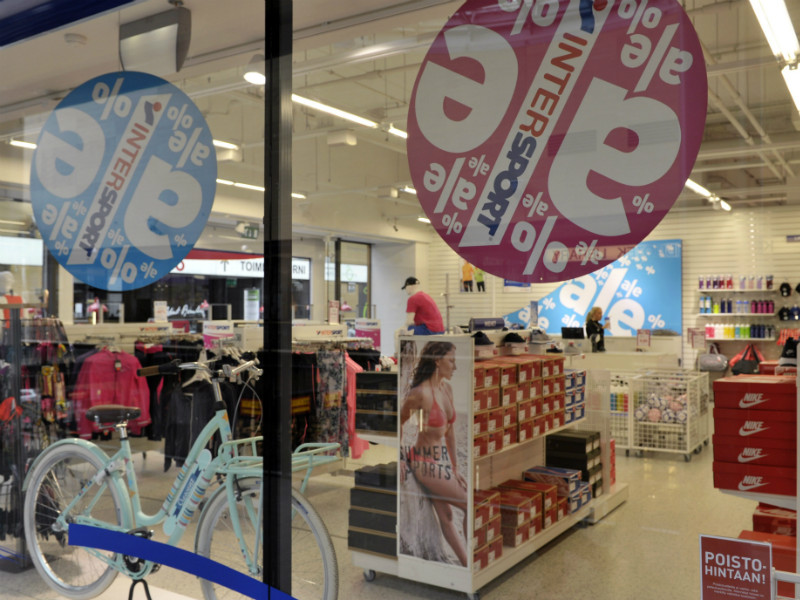 Sale signs in the windows of an Intersport shop in Iso Omena Shopping Centre in Espoo on 18 June, 2015.