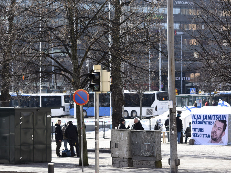 Suomi Ensin, an anti-immigration group, has erected its protest camp close to a public toilet in the corner of Helsinki Railway Square.