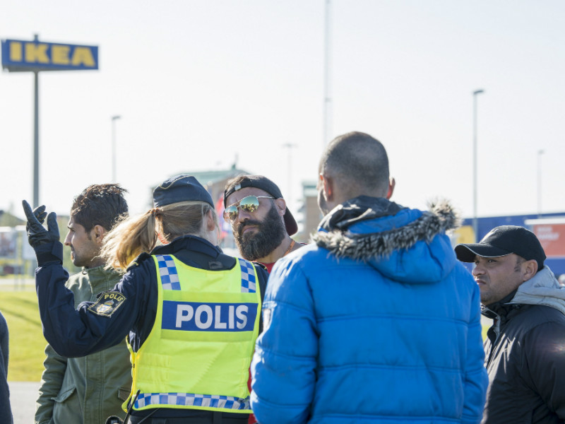 A Swedish police officer gave instructions to a group of people participating in a demonstration held by asylum seekers in Haparanda, a municipality located at the border between Sweden and Finland, on 5 September, 2017.