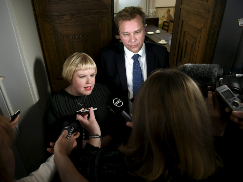 Annika Saarikko, the Minister of Family Affairs and Social Services, and Antti Kaikkonen, the chairperson of the Centre Parliamentary Group, were mobbed by reporters after a meeting of the Centre Parliamentary Group in Helsinki on Thursday, 19 October.
