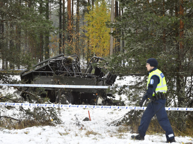 A police officer was pictured at the scene of a deadly collision between an off-road military lorry and a passenger train in Raasepori, Southern Finland, on Thursday 26 October, 2017.