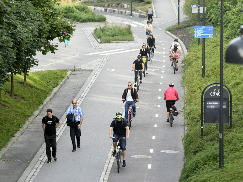 Cyclists and pedestrians on a cycleway in central Helsinki on 15 August, 2017. The Finnish capital has the fifth highest share of residents commuting by bicycle (11%) out of 20 large cities in Europe, according to an urban mobility index compiled by Politico.