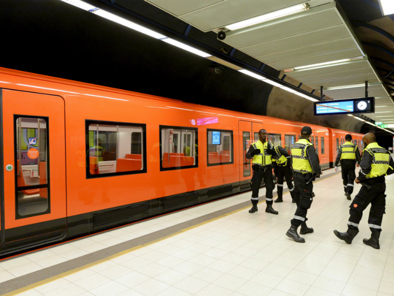 Security guards inspected a westbound metro train at Ruoholahti Station as test runs on the long-awaited western extension of Helsinki Metro began on 14 September, 2017.