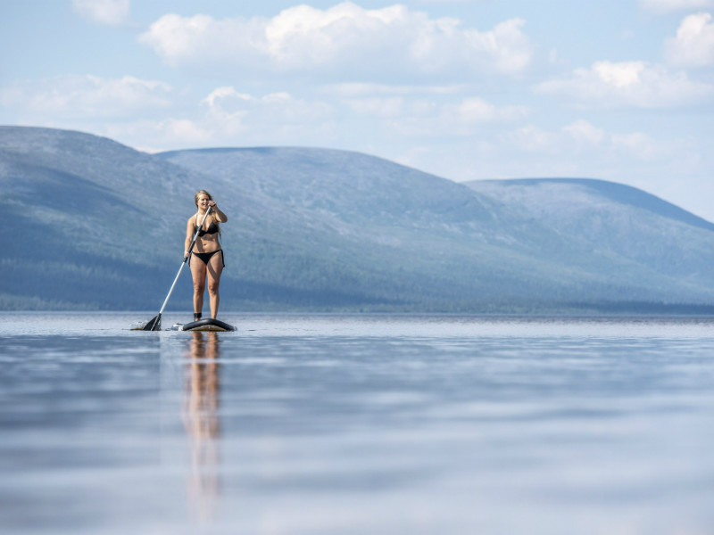 Santra Hostikka from Lappeenranta paddled on a stand-up paddleboard (SUP) against the picturesque backdrop of the Pallastunturi fells on Lake Pallasjärvi in Kittilä, Finnish Lapland, on 18 July 2018.