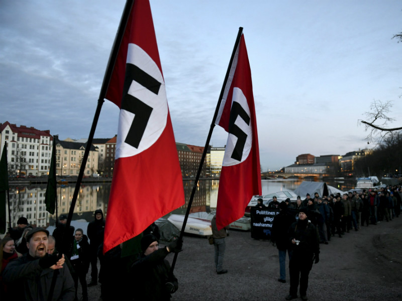 Neo-Nazis with swastika flags prepared for a protest march titled Kohti vapautta (Eng. Towards Freedom) in Kaisaniemi, Helsinki, on Thursday, 6 December. (Credit: Martti Kainulainen – Lehtikuva)