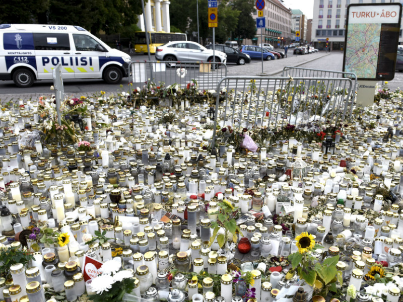 Candles and flowers at the scene of a series of stabbings that left two dead and eight injured in Turku, South-western Finland, on 18 August, 2017.