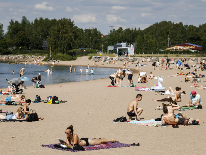 Sunbathers at Hietaniemi beach in Helsinki on 12 July 2018.