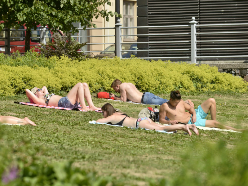 People sunbathing in Helsinki on 7 July 2018.