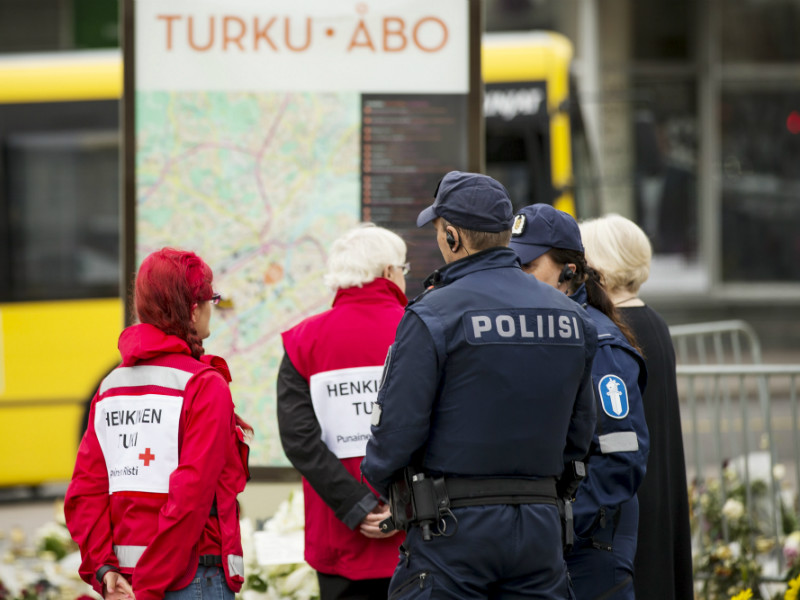 A photograph dated 23 August 2017 shows police officers and volunteers standing at the site of what has been confirmed as the first terrorist attack in the history of Finland.