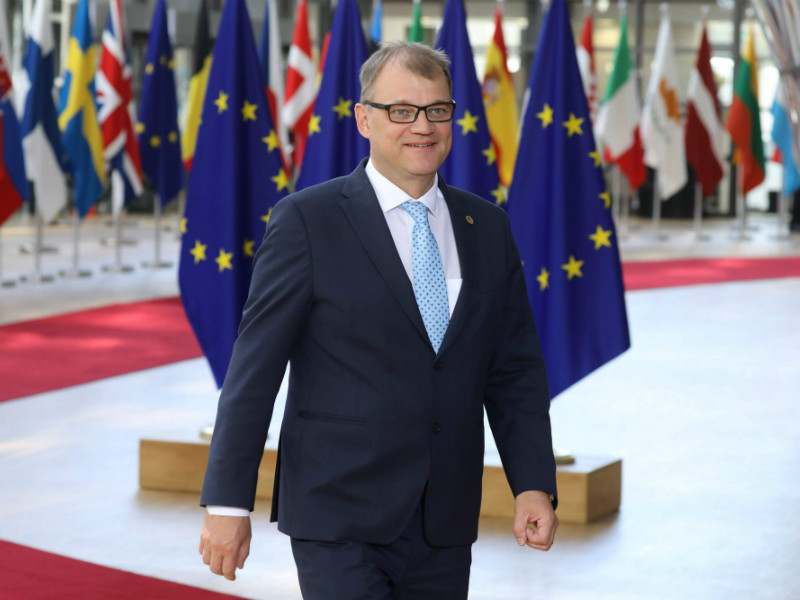 Finland's Prime Minister Juha Sipilä (Centre) was photographed arriving for an EU leaders' summit on Brexit, migration and eurozone reforms at the EU headquarters in Brussels on 28 June 2018. (Credit: Ludovic Marin – AFP/Lehtikuva)