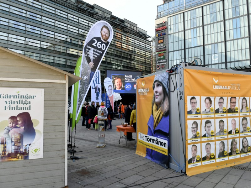 Campaign posters of candidates in this week's parliamentary elections at Narinkkatori Square in Helsinki on Saturday, 6 April 2019. (Martti Kainulainen – Lehtikuva)