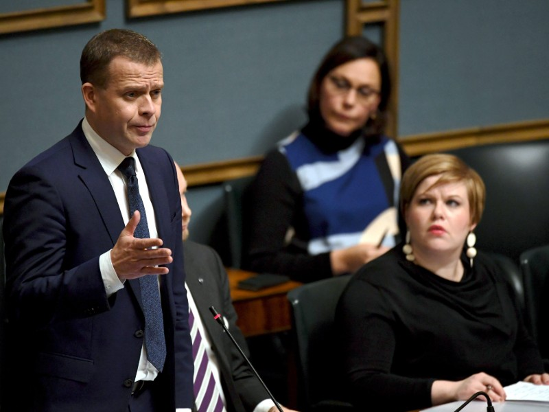 Minister of Finance Petteri Orpo (left) and Minister of Social Services and Family Affairs Annika Saarikko (front right) said the government plans to earmark additional funds for supervising elderly care. (Credit: Antti Aimo-Koivisto – Lehtikuva)
