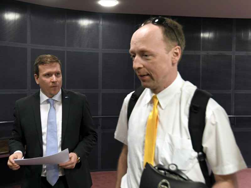 The Finns Party's Jussi Halla-aho (right) and Ville Tavio (left) leaving a meeting of the right-wing party's parliamentary group meeting in Helsinki on 7 June 2019. (Markku Ulander – Lehtikuva)