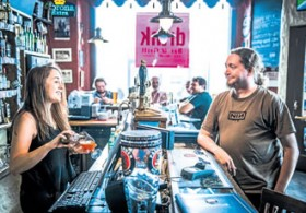 Game programmer Miikka Kulmala orders an Estonian microbrewery Hopster beer from Kerstin Meresma at Drink Bar & Grill Old Town in Tallinn.