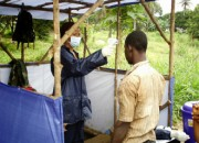 Soldiers manning Ebola checkpoints bring back war memories