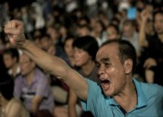 China defends Hong Kong democracy plan as protests break out