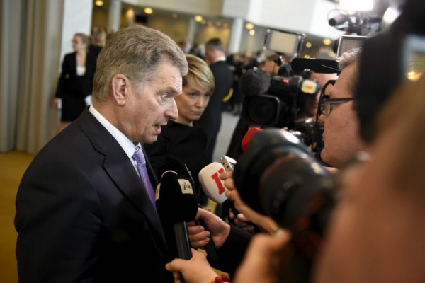 President Sauli Niinistö was surrounded by members of the media after the opening ceremony of the new parliamentary session on Wednesday, 3 February.