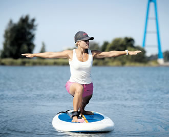 Exercise firm Erimover's CEO, SUP instructor Sonja Lauren presents SUP paddling at Helsinki's Hietaniemi beach on 4 August.