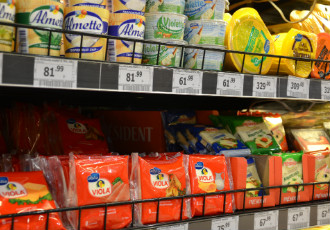 Valio's Oltermanni and Viola cheeses alongside other products on the shelf of a grocery store in Moscow, Russia.