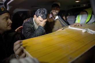 Relatives of a casualty from the Taliban attack on a school in Peshawar mourn as they depart from the Lady Reading Hospital in Peshawar, Pakistan.