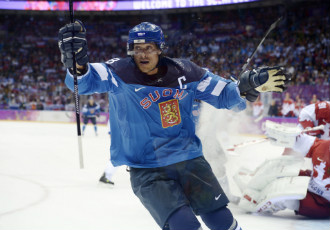 Captain Teemu Selänne celebrates after finding the net at the end of the first period to take Finland into the lead.