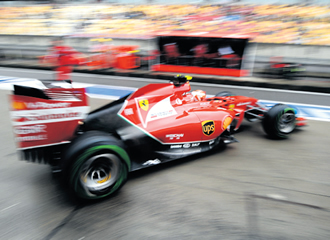 Raikkonen leaves the pit during a practice session of the Formula One Chinese Grand Prix in Shanghai.