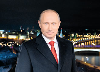 Russian President Vladimir Putin stands during a TV address to the nation on 31 December in Moscow.
